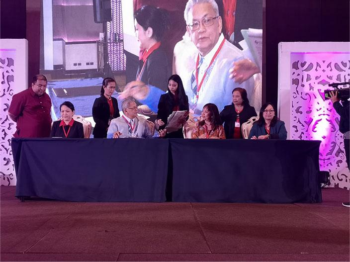 Representatives from CEM and Miriam College sign the MOA on the CEM-MC Scholarship Project